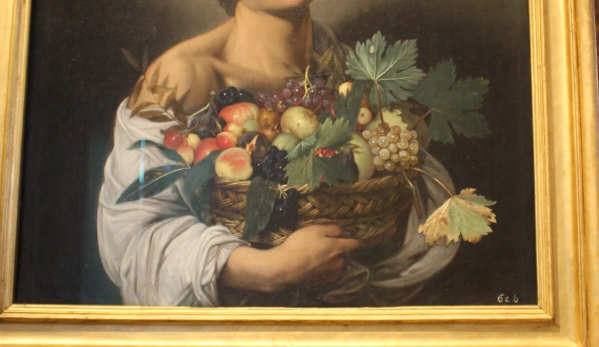 Caravaggio Boy with a fruit painting