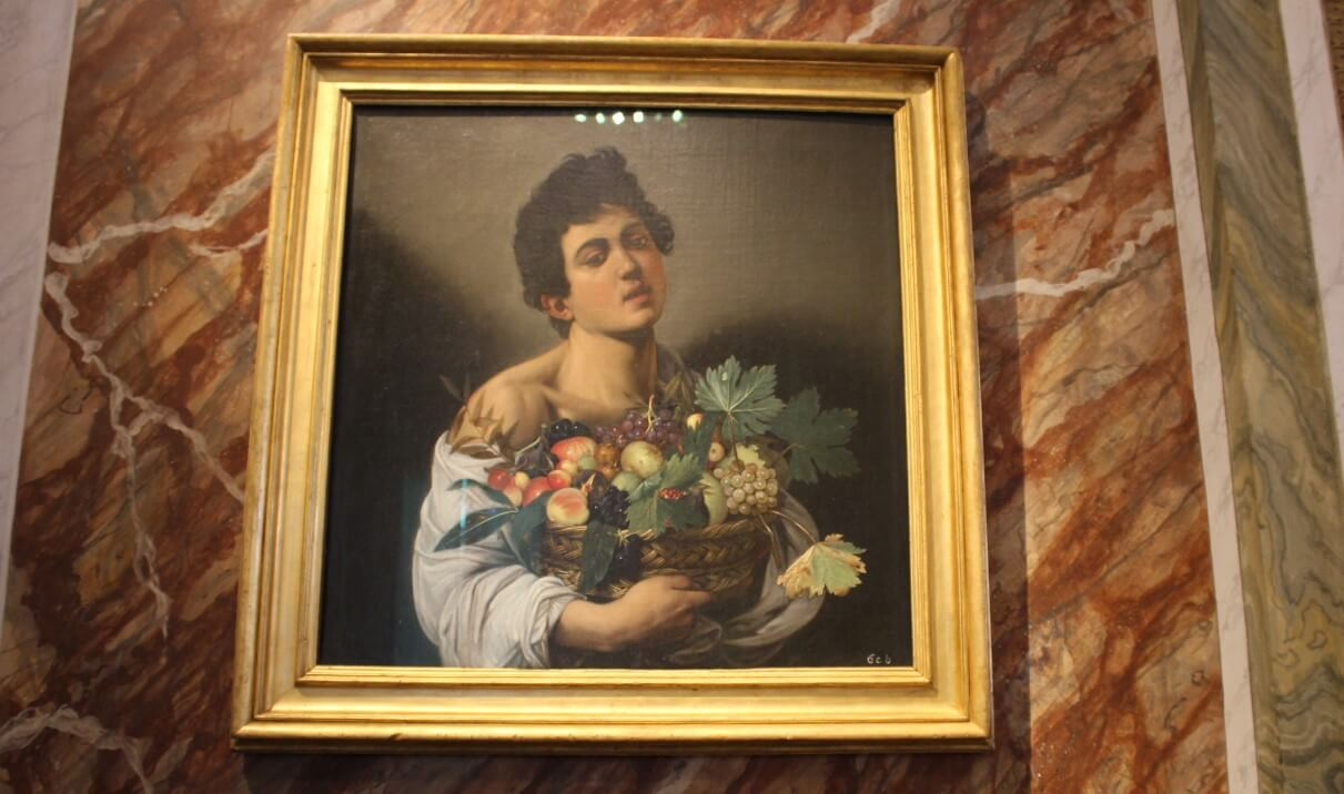 The boy with a basket of fruit caravaggio